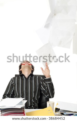 Man sitting at desk throwing up paperwork - stock photo
