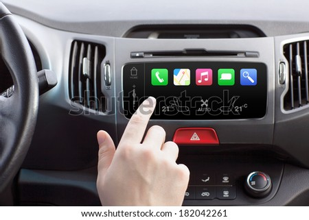 man sitting in a car and touch play finger in a auto smart system  - stock photo