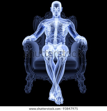man sitting in a chair under the X-rays. - stock photo