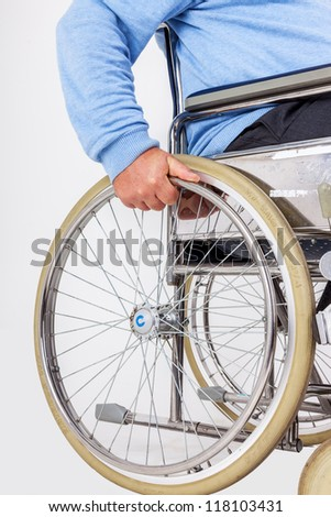 Man sitting in a wheelchair - stock photo