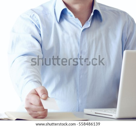 Man sitting in front of a laptop