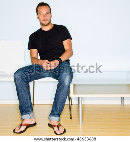 Man sitting in waiting room - stock photo