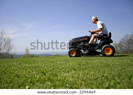man sitting on a lawnmower