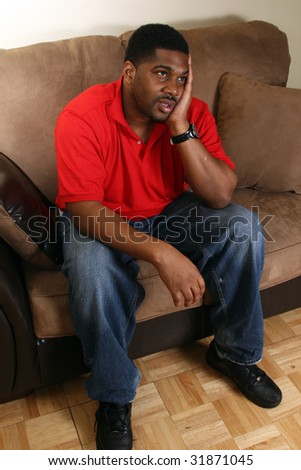 Man sitting on couch in living room