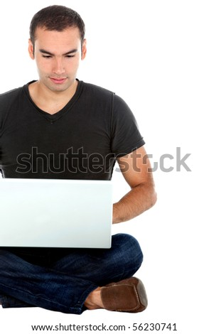 Man sitting on the floor with a laptop - isolated over a white background - stock photo