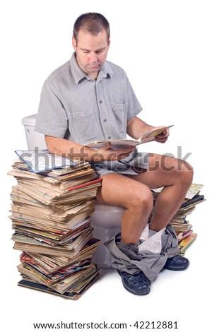 man sitting on the toilet - stock photo