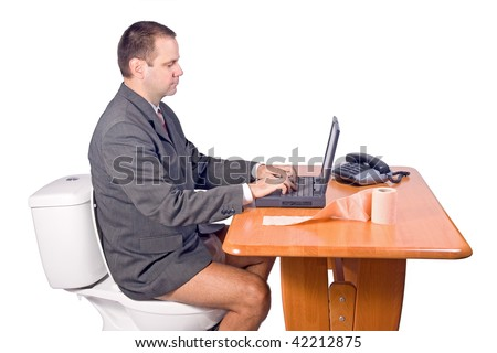 man sitting on the toilet in office - stock photo