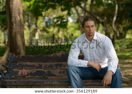 Man sitting outdoors in park