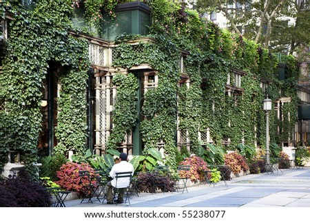 Man sitting outside the Bryant Park Cafe. Manhattan, New York. - stock photo