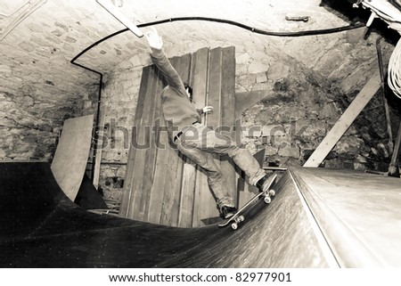 Man skating a half pipe - stock photo