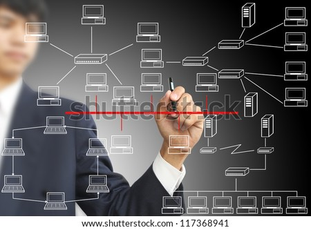 Man sketching computer network - stock photo