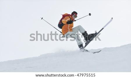 man ski free ride downhill at winter season on beautiful sunny day and powder snow - stock photo