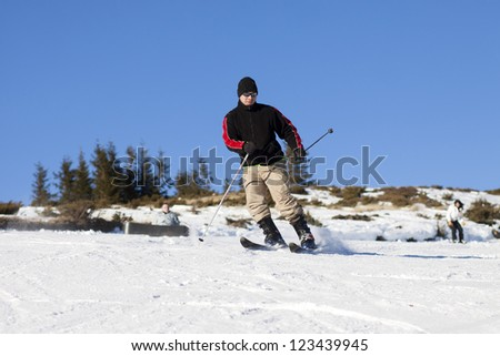 Man skiing - stock photo