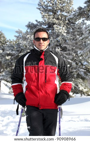 Man skiing alone - stock photo