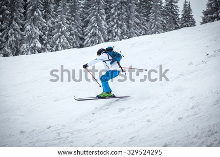 Man skiing on slope - stock photo
