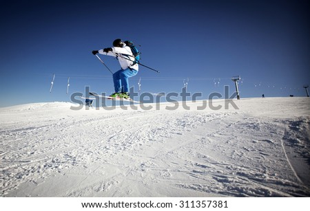 Man skiing on slope - winter holidays - stock photo