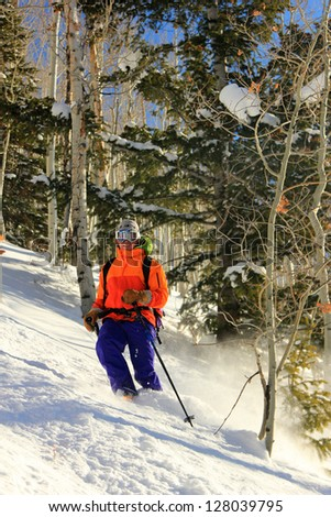 Man skiing through a forest in the Utah mountains, USA. - stock photo