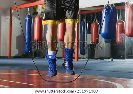 Man Skipping Rope in Boxing Gym - stock photo