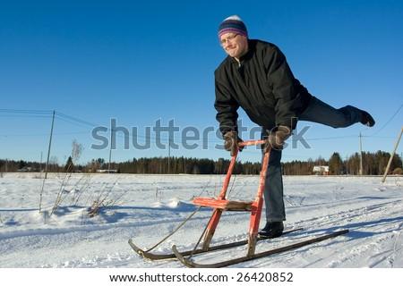 Man sledding - stock photo