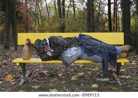 Man sleeping on a park bench - stock photo