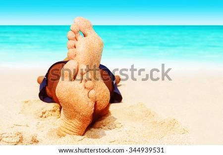 man sleeping on the beach - stock photo