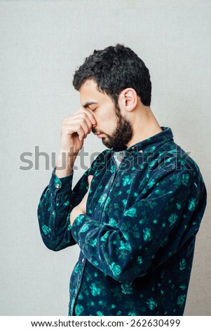 man sleeping over gray background - stock photo