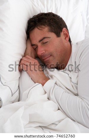 Man Sleeping Peacefully In Bed - stock photo