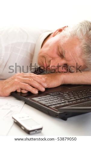 man sleeping with laptop - stock photo