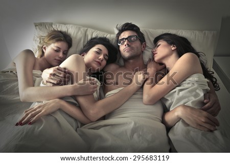 Man sleeping with three girls - stock photo