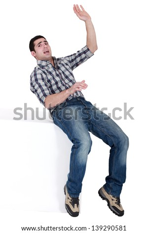 man slipping and falling - stock photo