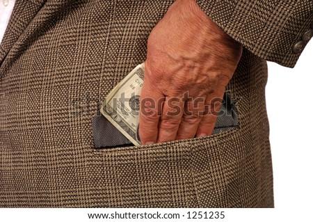 Man slips twenty into pocket - stock photo