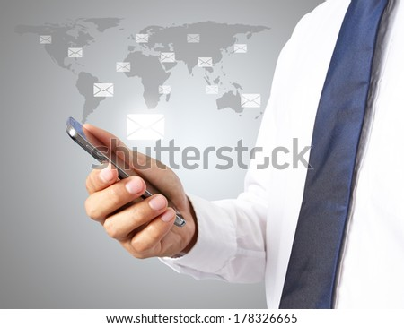 Man smart phone with e-mail icons on grey background - stock photo