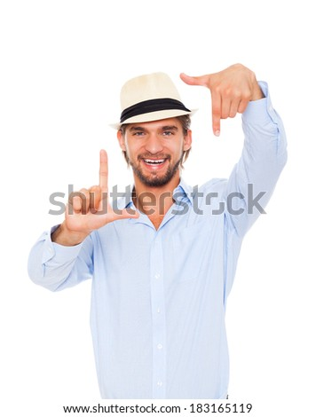 Man smile making frame picture with hand fingers, taking snapshot photograph camera, wear casual blue shirt fashion hat, isolated over white background - stock photo