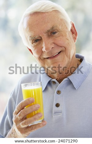 Man Smiling At Camera And Drinking Orange Juice
