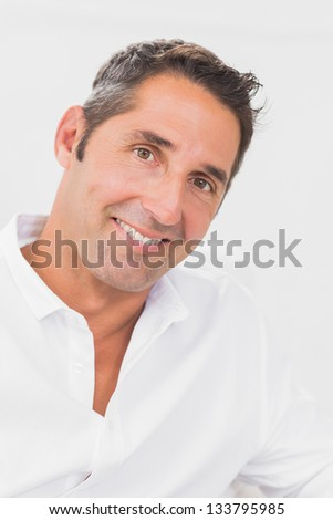 Man smiling at camera on the white background - stock photo