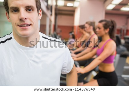 Man smiling in gym wearing white t-shirt
