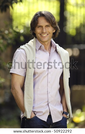 Man smiling in the garden - stock photo