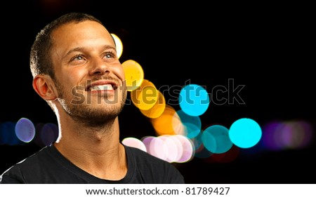 man smiling wearing casual clothes in the city - stock photo