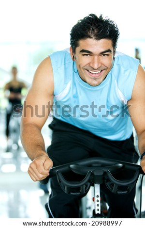 man smiling while in a gym