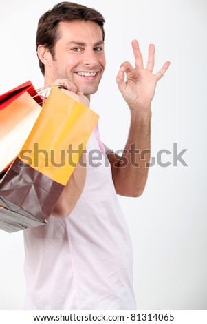 Man smiling with shopping bags - stock photo