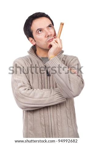 man smoking a cigar and looking serious - stock photo