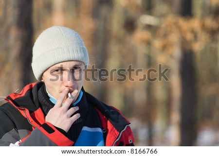 Man smoking in a winter day