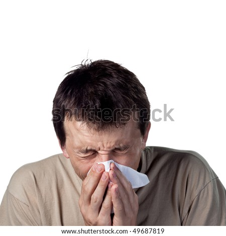 Man sneezing into a tissue - stock photo