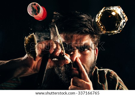 Man snorting a line of cocaine  - stock photo