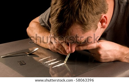 man snorting cocaine - stock photo