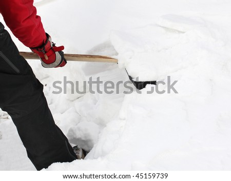 Man snow cleaning by a shovel - stock photo