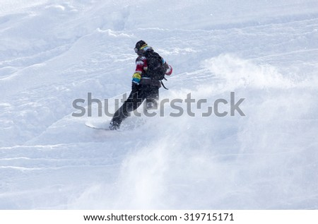 man snowboarding in the snow - stock photo