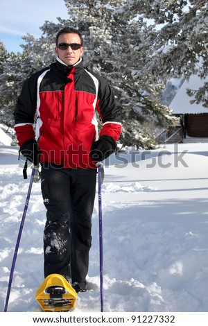 Man snowshoeing - stock photo