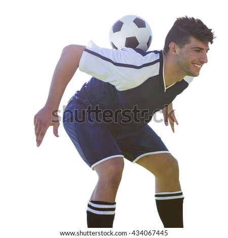Man soccer player keeping the ball on his back on a white background - stock photo