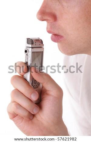 Man speak in dictaphone. Closeup - stock photo